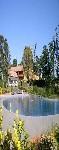 hébergement d'exception Gers - L'immense piscine en forme de lac