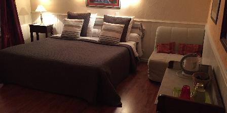 La Maison de Brian et Christiane Chambre Abricot grand lit