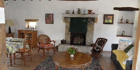 Les Houlins Living room with wood burning stove