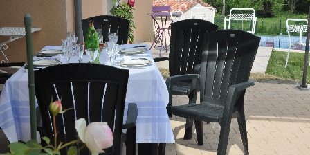 Aux 4 Saisons Meals served on a shaded terrace, In Pyrénées France