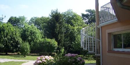 Aux 4 Saisons Park in summer, cottage
