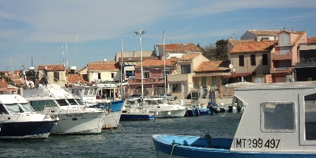Location Saisonnière Gaby La Petite Maison de Pêcheurs Vue maison du port